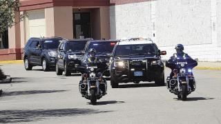 officers driving in formation as a birthday parade